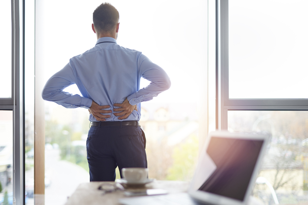 Man with back pain needs chiropractic care in Atlanta, GA.